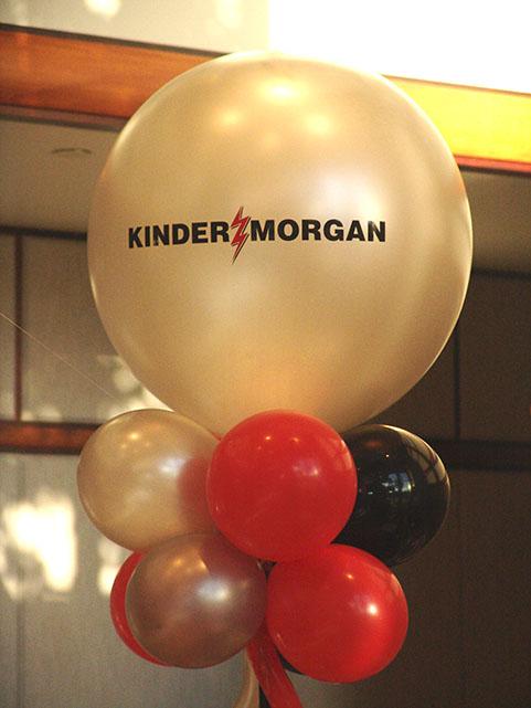 large logo topped balloon column denver